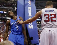 Oklahoma City's Serge Ibaka (9) leans against the pad on the goal after fouling Los Angeles' Blake Griffin (32) and then having Griffin fall back on him out of bounds in the fourth quarter during Game 4 of the Western Conference semifinals in the NBA playoffs between the Oklahoma City Thunder and the Los Angeles Clippers at the Staples Center in Los Angeles, Sunday, May 11, 2014. Photo by Nate Billings, The Oklahoman