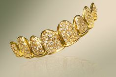 The Dubai Liberty Dental Clinic's Golden Grill Costs a Whopping $153,000 #bizarre #trends trendhunter.com