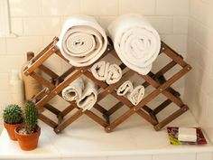 A wine rack in the bathroom is a clever way to keep a few towels right at hand.