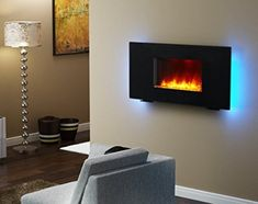 Best wall mount electric fireplace: PuraFlame Galena Black Remote Control Portable Wall-mounted Flat Panel Fireplace Heater Source by Portable Electric Fireplace, Electric Fireplace Reviews, Recessed Electric Fireplace, Best Electric Fireplace, Electric Fireplace Heater, Electric Fireplaces, Wood Mantle Fireplace, Wall Mounted Fireplace, Modern Fireplace