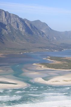 aerial view from whale watching tour, Hermanus Lagoon breaching Grotto Beach, South Africa