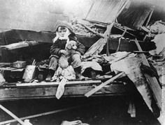 A boy and his dog recovering after the Great Tri-State Tornado of 1925, the deadliest tornado in US history.
