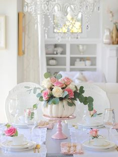 crystal chandelier, crystorama chandelier, white faux pumpkin floral arrangement, romantic floral brunch tablescape, girls table, brunch table, girlfriends party, fall party, fall tablescape, blush pink ruffle dinner linen napkins, white ruffle table runners, gold flatware, white beaded pottery barn dishes, white beaded world market dishes, gold rimmed goblets wine glasses, pink tablescape, pink table decor, place settings