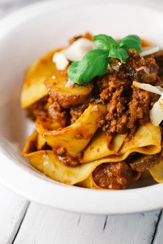 Beef Bolognese with Pappardelle Pasta - Your family will ask for seconds of this recipe! Lean ground beef is simmered in a crushed tomato sauce.   jessicagavin.com