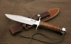 """Randall Model 1 7"""" stainless steel Tactical Combat & Fighting Knife and leather sheath with sharpening stone."""