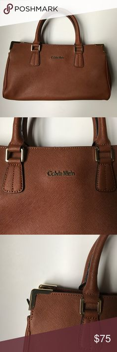 Calvin Klein Purse Beautiful Calvin Klein leather purse. 3 compartments and an inner zip pocket. 13 inches wide. Body 7 inches tall. 12 inches tall with handles extended Calvin Klein Bags Satchels
