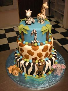 Good idea for this babies first birthday if I stick with the jungle theme. But with pink tutus and bows on the animals Cupcakes, Cupcake Cakes, Jungle Cake, Jungle Safari, Jungle Animals, Baby Shower Games For Large Groups, Rodjendanske Torte, Jungle Theme Birthday, Safari Cakes