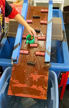 Build a water ramp for your sensory table and watch the experimenting begin!