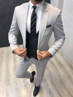 Collection: Spring Summer 2019 Product: Slim-Fit Wool Suit Color Code: Gray Size: Suit Material: wool royal lycra Machine Washable: No Fitting: Slim-fit Package Include: Jacket Vest Pants Only Gifts: Shirt Chain and Neck Tie Best Suits For Men, Cool Suits, Mens Suits, Suit For Men, Grey Slim Fit Suit, Blue Suit Men, Mens Slim Fit Suits, Formal Men Outfit, Formal Suits