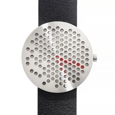 The Bikpua is defined by a circular case punctured with a grid of hexagonal holes, partially revealing the hands underneath. The perforated face is comprised of brushed stainless steel. #watches #design