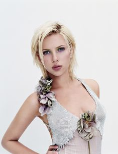 Charming seductress Scarlett Johansson ... Select Beauty... Following minor roles in the 1995 film Just Cause, as the daughter of Sean Connery and Kate Capshaw, and If Lucy Fell in 1996, she played the role of Amanda in Manny