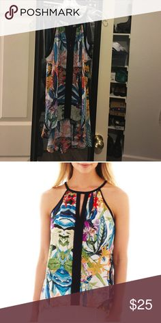 nicole by Nicole Miller® Floral Print Top Spaghetti strap, lightweight with a high low design.  Sheer like but a nude Bra blends in nicely. Delicately worn. No stains. Dry clean keeps it good as brand new.  Perfect for Spring & Summer. 🌸🌺☀️ Nicole by Nicole Miller Tops Tank Tops