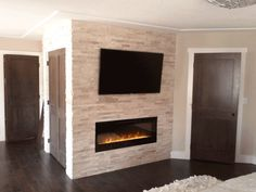 Interior, Natural Interior With Stone Fireplace Wall With Brick Wall And Large LED TV And Wooden Floor And Iron Cover: Stone Fireplace Wall for Great Warm Vibe