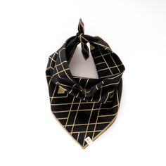 RAMSES. Dog bandana or baby bib in black and gold geometric trim with tan trim. Sizes: XS - XL. Egyptian pattern dog bandana with metallic gold accents. For the powerful pooch with a taste for class. $26.