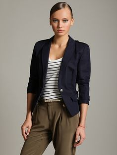 my professor had an outfit similar to this. black blazer+ khakis and a string of pearls. LOVE & inspired!