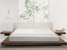 Tokyo Platform Bed.  In Walnut or Wengue.  Beds should low to the ground to maximize the visual space in a room.