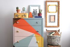 [While not the colours I'd choose, this painted dresser is fantastic - love the idea]