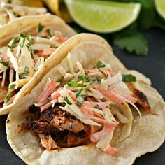 Easy Fish Tacos are a healthy option for a delicious weeknight dinner. Wild haddock fillets are marinated, oven baked, and topped with a spicy cabbage slaw. Slaw For Fish Tacos, Easy Fish Tacos, Lettuce Tacos, Shrimp Tacos, Whole30 Fish Recipes, Entree Recipes, Seafood Recipes, Healthy Recipes, Tilapia Recipes