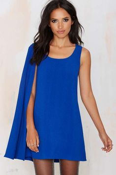 The asymmetrical silhouette and wide scoop neck on this gorgeous bright blue dress can take your from a 90's night with chunky heels to a high-fashion moment with some statement accessories.