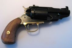 Quite the Beast, snub nosed 1858 New Army Remington revolver, converted to cartridge, with modified handle and grip.