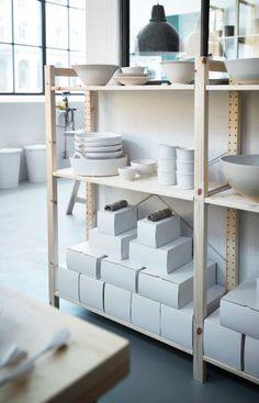 Pottery displayed on IVAR solid pine shelving unit