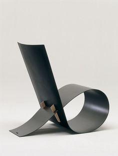 The sleek lines of the 1997 Loop chair by Niels Hvass