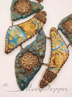 a really interesting use of filigree and cone ends.....love the combinations of clay and metals