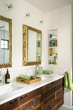 This custom bath vanity has a salvaged-barn-wood base and a Silestone top. The homeowners bought the ornate frames in Peru and asked their general contractor to add the mirrors.