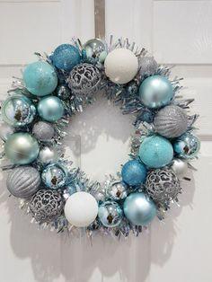 Christmas wreath tinsel wreath blue and silver wreath Christmas Swags, Outdoor Christmas Decorations, Christmas Baubles, Holiday Wreaths, Christmas Diy, Turquoise Christmas, Silver Christmas, Blue Baubles, Ornament Wreath