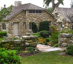 ~a beautiful stone cottage with stone garden wall in Carmel, CA~