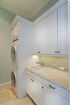 Love the white laundry room!