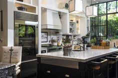 Michele Evans, wife of D.C. Council member Jack Evans, designed the kitchen of her family's Georgetown home to suit the needs of a large and busy family. The large marble center island is a gathering place, where each day she prepares a glass dispenser full of fruit and herb water. There is also a trail mix of the week for snacking.