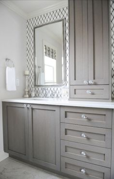 bathroom with lattice tile, gray vanity, crystal knobs, white counters, chrome fixtures, built in storage tower