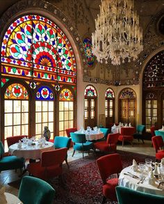 A historic home in Kashan, Iran converted to a beautiful hotel. Stained glass windows, antique rugs, ceramics and doors surrounding the room create an environment like no other. Persian Architecture, Architecture Design, Hotel Architecture, Persian Restaurant, Deco Cafe, Iran Pictures, Visit Iran, Teheran, Iran Travel