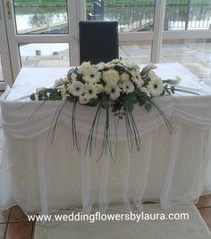Top table arrangement of gerberas with purple calla lilys, steel grasses , www.weddinglfowersbylaura.com #lionquays hotel