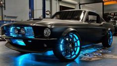The Ultimate Dream Car - tricked out 69' mustang with luminous blue wheels