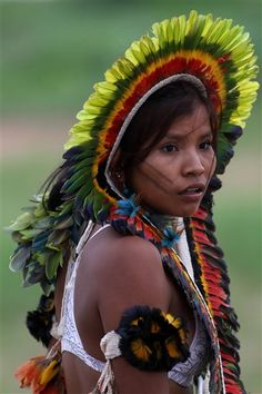A young Rikbaktsa Indian woman attends the Indigenous Games on the island of Porto Real in the city of Porto Nacional, Brazil, Tuesday Nov. 8, 2011. Indigenous people from 38 ethnic groups are participating in the XI Indigenous Games, in which athletes compete in disciplines like archery, spear throwing, canoeing, swimming, among other sports. (AP Photo/Eraldo Peres)