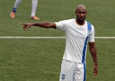 French football striker Nicolas Anelka participates in a training session of Mumbai City Football Club team at Cooperage Ground in Mumbai on October 1, 2014.  The Mumbai City FC begins play in October 2014 during the inaugural season of the Indian Super League (ISL).