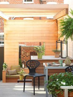 A simple wood-slat wall adds privacy to this backyard getaway. More simple outdoor spaces: http://www.bhg.com/home-improvement/porch/outdoor-rooms/small-outdoor-living-spaces/?socsrc=bhgpin050913woodwall=11