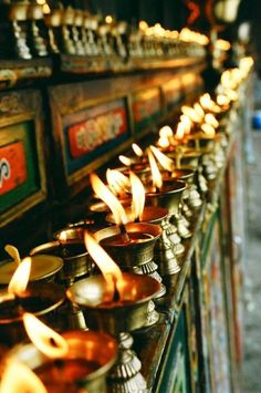 Kham region of Tibet: yak butter candles on an altar Nepal, Breathing Fire, Buddha, Religion, Art Asiatique, Spiritus, Tibetan Buddhism, Tibetan Symbols, Tibet