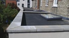 Best and inexpensive options on caping a parapet wall