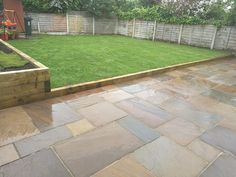 Indian stone patio with real grass raised area.