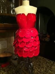 This is a dress I made out of red solo cups! It's on a half scale and I used about 100 plastic cups and hot glue to keep it together! Red Solo Cup, Star Events, Sewing Blogs, Plastic Cups, Diy Furniture, Christmas Stockings, Repurposed, Recycling, Lights