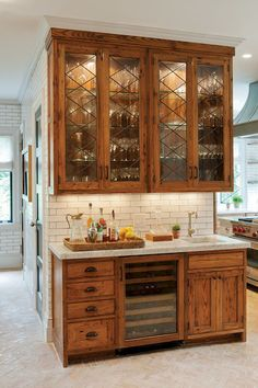 Crown Point Cabinetry installed a wet bar and drinks cabinet made of reclaimed American chestnut in the renovated kitchen of a Dutch colonial house in Connecticut. Photograph by Crown Point Cabinetry Farmhouse Kitchen Cabinets, Kitchen Backsplash, Kitchen With Wood Cabinets, Kitchen Cabinetry, Oak Cabinet Kitchen, Farmhouse Kitchens, Kitchen Counters, Kitchen Sinks, Backsplash Ideas