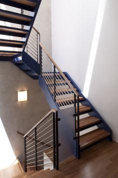 Fabulous Stair Railing decorating ideas for Arresting Staircase Modern design ideas with handrail metal railing minimal neutral colors open risers sconce wall lighting wood