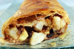 Pear and Apple Strudel stuffed with piping hot pears, apples, walnuts and butter plumped raisins bursting with winter spices and crispy Phyllo dough Apple Strudel, Phyllo Dough, Apple Pear, Dessert Recipes, Desserts, Coffee Cake, Raisin, Baked Goods, Bakery