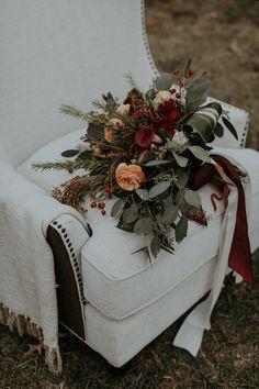 Red wintry wedding bouquet  | Image by B. Matthews Creative
