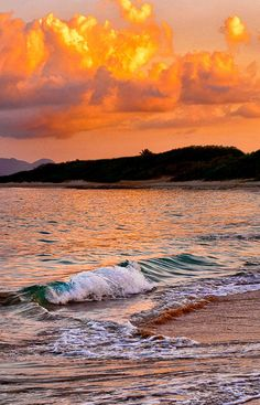 Rolling waves and sunset at Zenaida Beach and Tennis Estate.