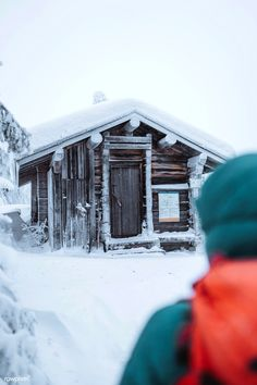 Woman walking to a hut in the snowy woods | free image by rawpixel.com / Jack Anstey