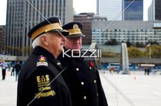 side view of senior citizens in military uniform. - Side view of senior citizens in military uniform.